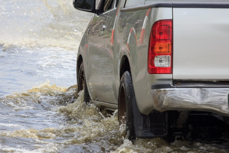 Truck driving on flooded street