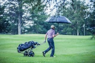 Golfer on stormy day